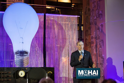 Washington Governor Jay Inslee addresses the crowd during a launch event for the Bezos Center for Innovation at the Museum of History and Industry in Seattle