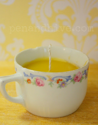 beeswax candle in teacup