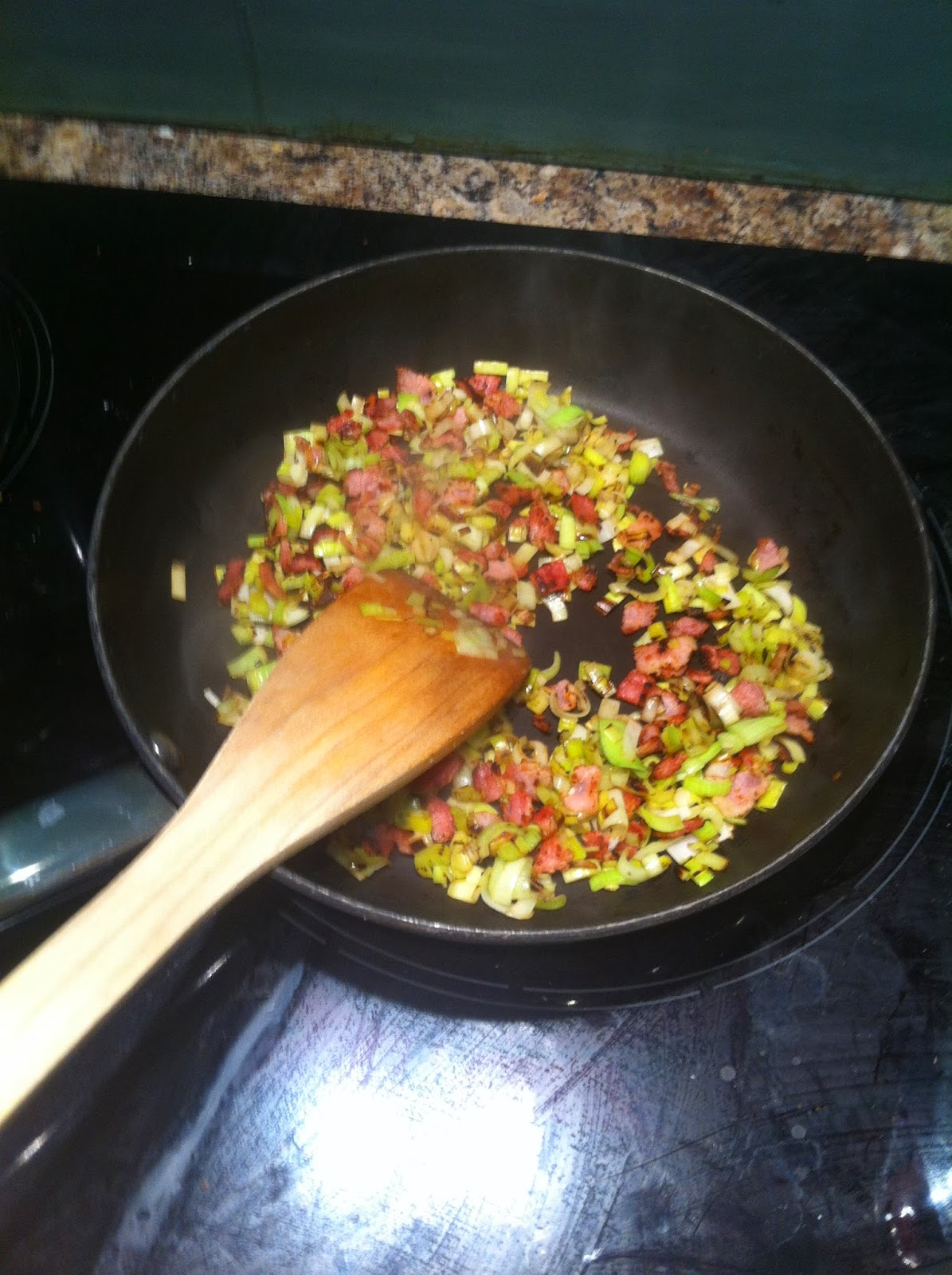 Frying leeks and bacon