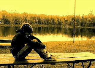 sad boy alone near river-Sad love Shayari