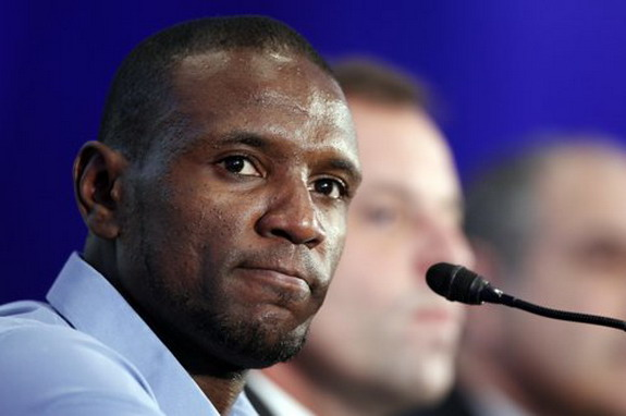 Barcelona player Éric Abidal looks emotional during a news conference at the Camp Nou