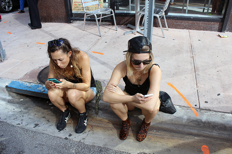 Social media on the curb, downtown Miami