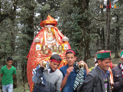 Group of devotees taking the idol to the temple