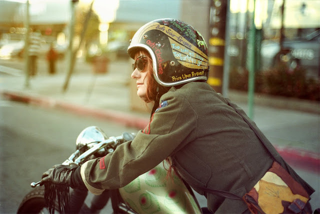 Sara waering a painted helmet and her Triumph