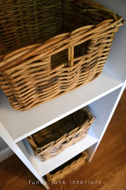 How to build an easy clothes closet from a $50 kit! Ikea basket storage in cubbies.   funkyjunkinteriors.net