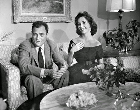 At home with second husband, Mike Todd. (He would later die in a plane crash).