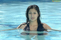 Alluring LAKSHMI RAI spicy stills,cleavage show, hot in tamil actress photos, swimming pool pics, wet and sexy in pool, pole dance