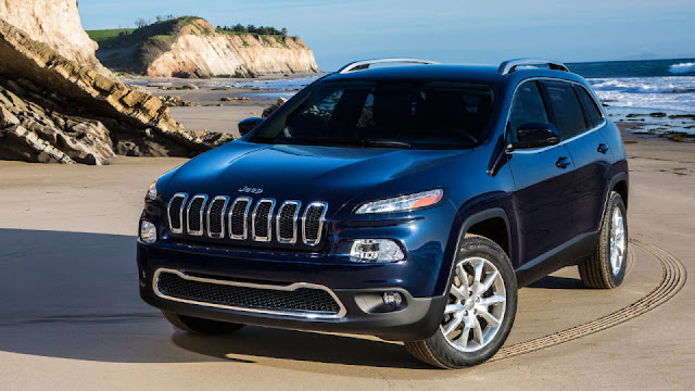 Dark blue 2014 Jeep Cherokee at the seashore