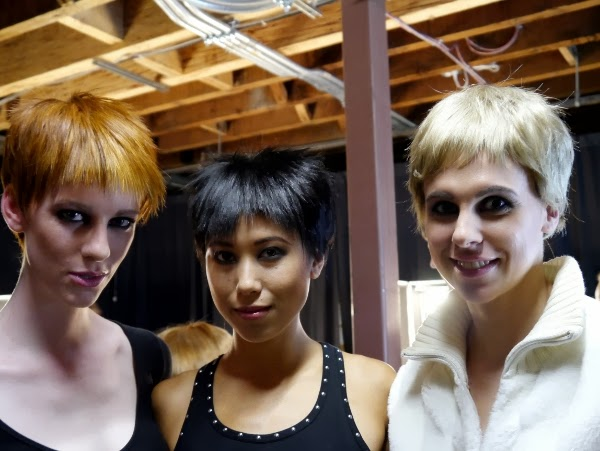 Three models show off the punk/androgyny-inspired hair and makeup look by La Biosthetique at Nicole Bridger fall/winter 2013 at Eco Fashion Week.