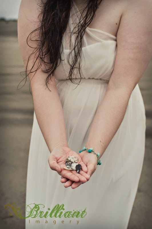 Bride holds seashells at Long Beach - Patricia Stimac, Seattle Wedding Officiant
