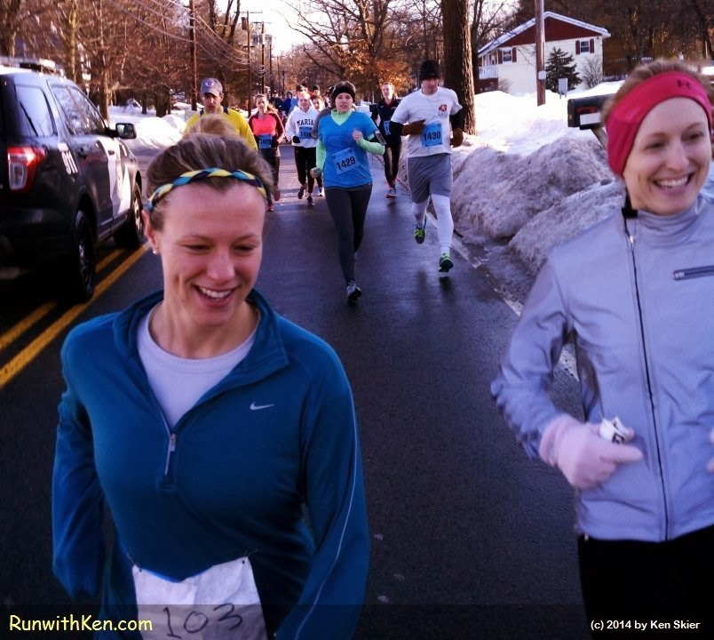 Two happy runners, smiling and laughing as they run the Fudgcicle 5K in Tewksbury, MA.