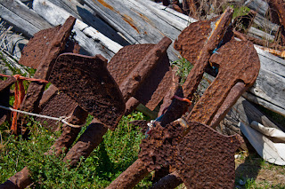 rusted anchors in favignana