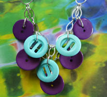 Plunging Necklace has Double Layers of Teal and Purple Fashion Buttons Hanging from Strands of Silver Chain