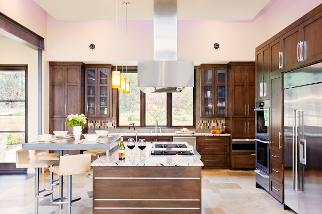 Photo of modern kitchen interiors with the furniture made of dark brown wood