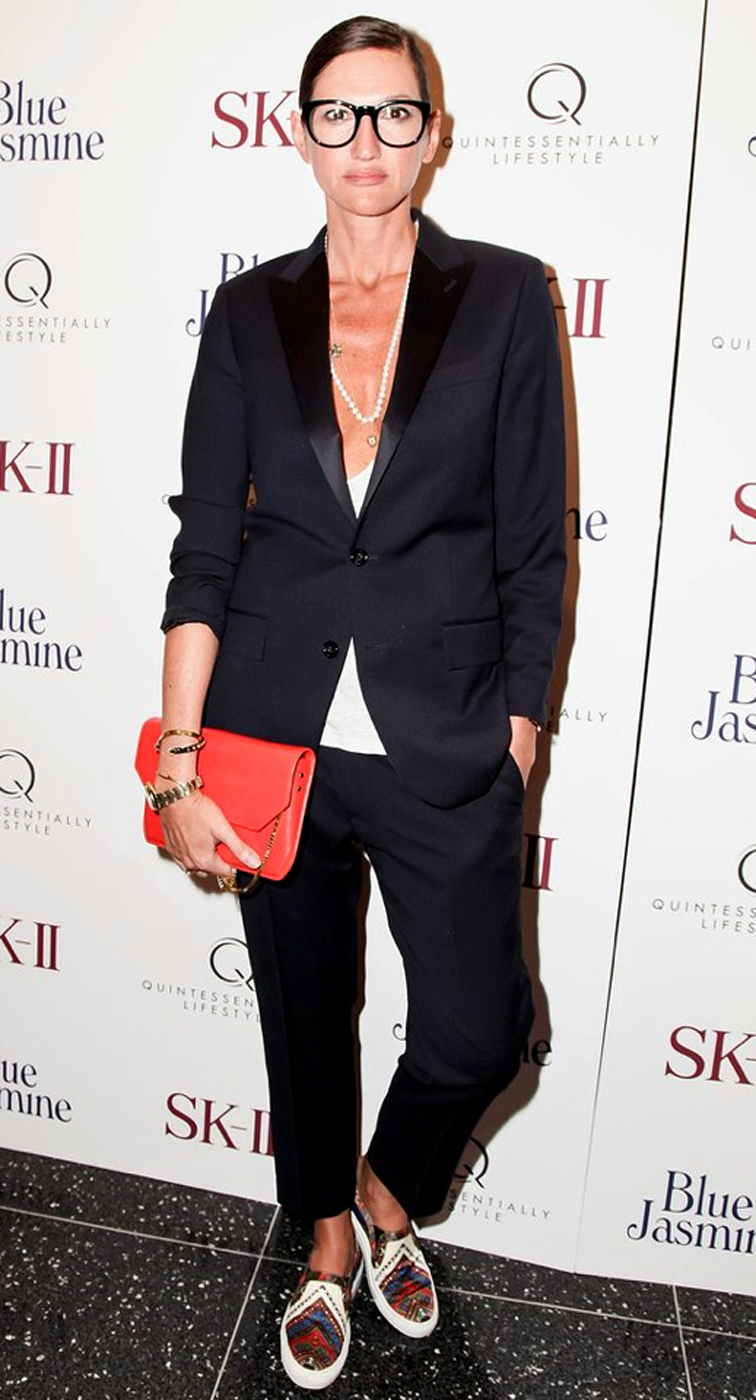 Jenna Lyons black suit Givenchy slip on sneakers