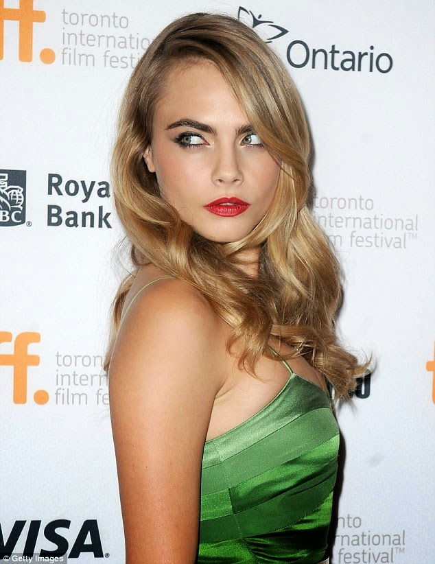 Cara Delevingne dresses up in green for 'The Face of an Angel' Toronto Film Festival Premiere
