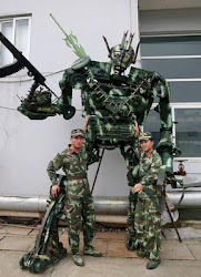 Chinese soldiers turn waste parts of military vehicles into a 4-meter–high transformer