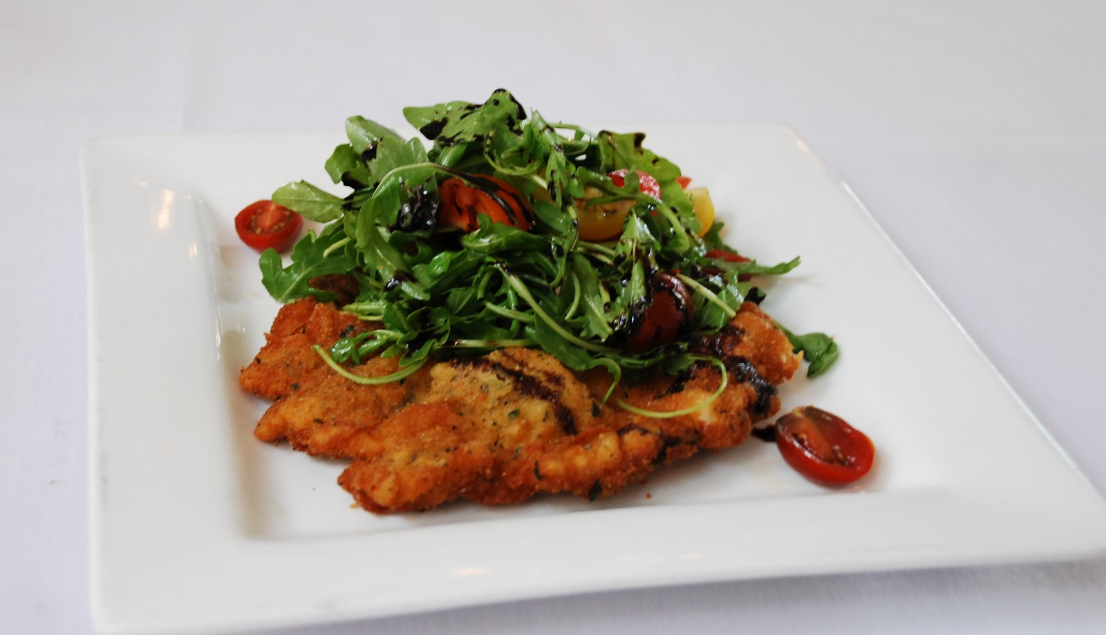 Chicken Milanese with Arugula Salad, Tomatoes and Balsamic Reduction