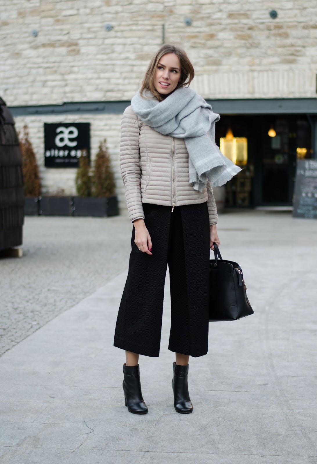 kristjaana mere black textured flared culottes winter outfit