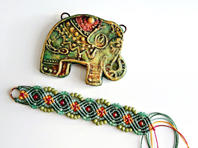 Polymer pendant and macrame knotting.