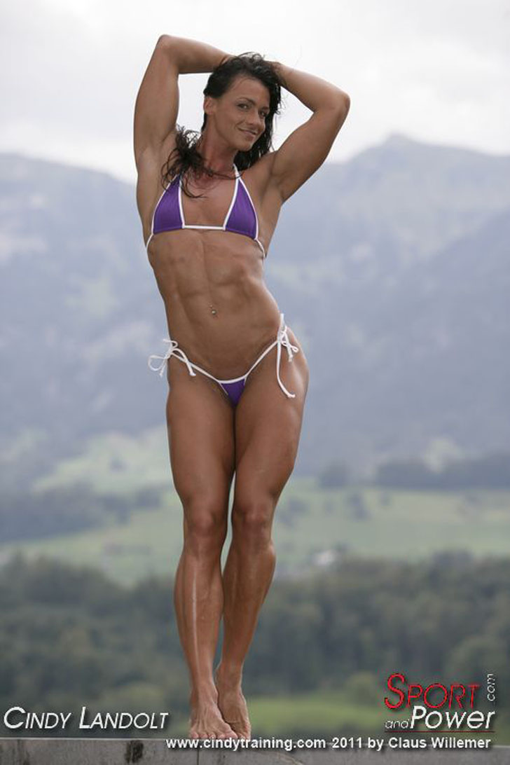 Cindy Landolt Flexing Her Ripped Abs In A Purple Bikini
