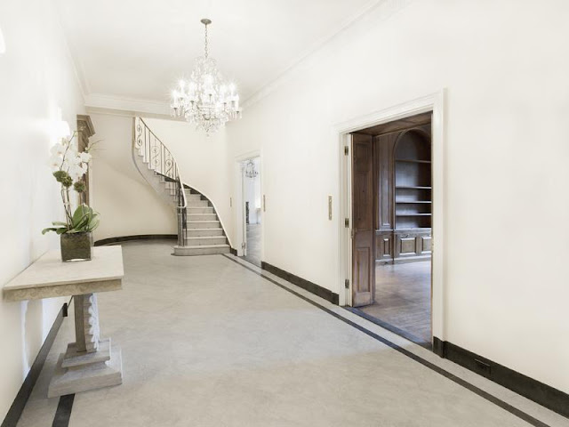 foyer with grand staircase and chandelier