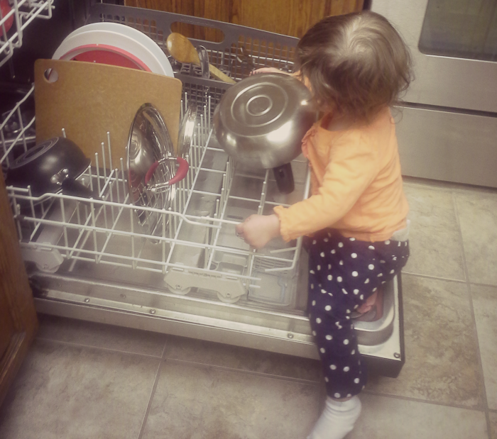 Little e doing the dishes