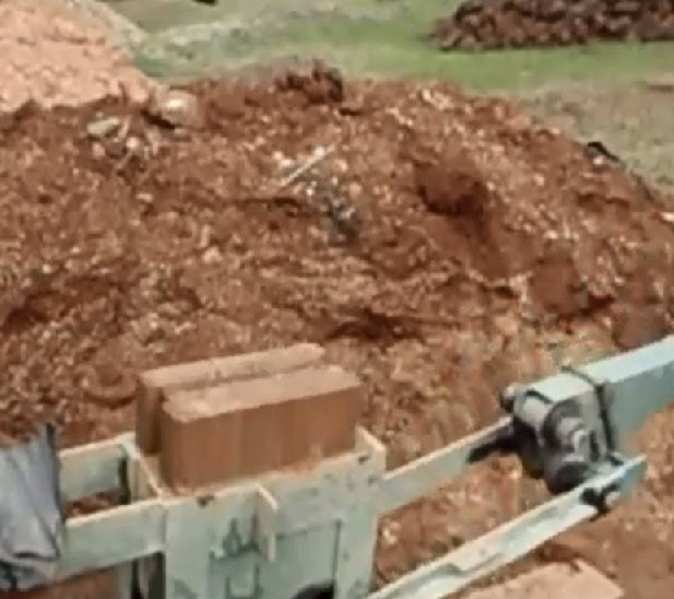 Cement stabilized soil is pressed to form brick