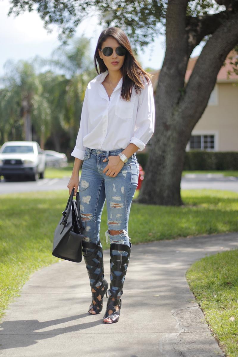 White button up, lovers + friends jeans, black celine bag, sandal boots