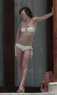Milla Jovovich Hot Topless and Bikini in Los Cabos