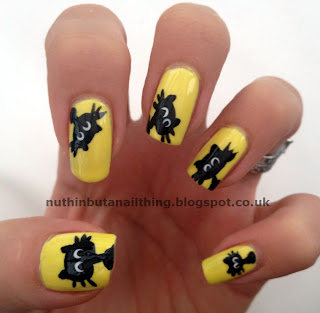 yellow cat nail art