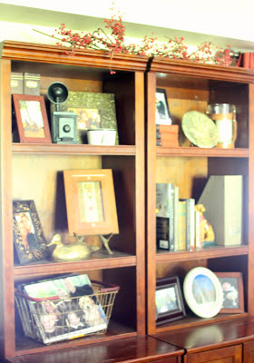 Styled Bookshelves with scrapbook paper backing via www.goldenboysandme.com