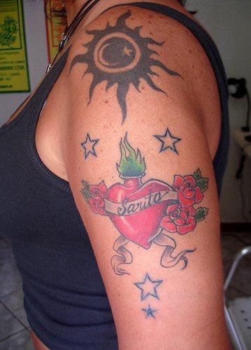 Designed heart sun moon & stars arm tattoo
