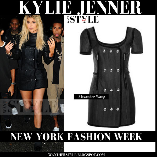 Kylie Jenner in black mini dress with silver buttons Alexander Wang Trapunto new york fashion week front row