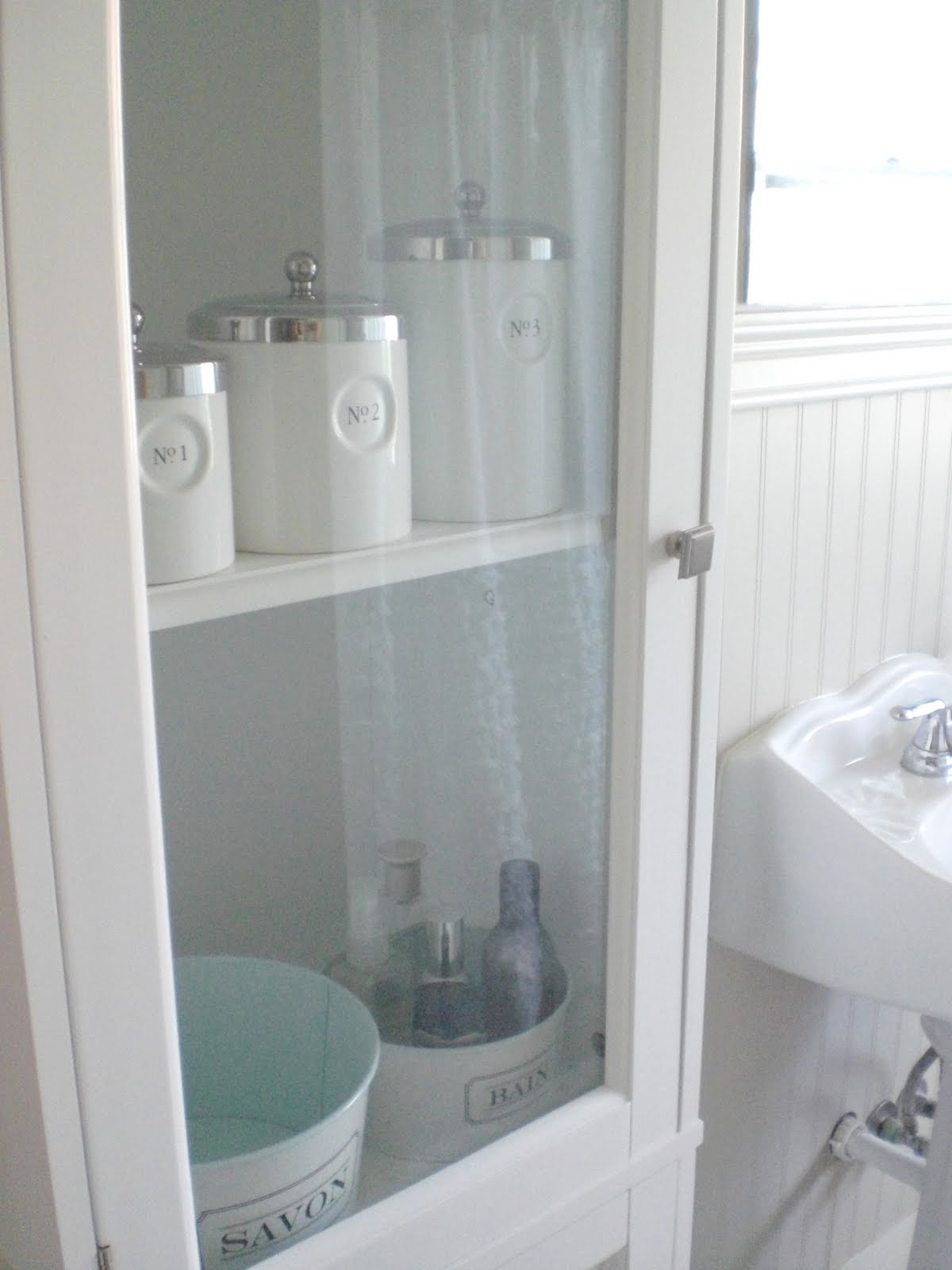 Our Solution Was This Glass Door Armoir From Target (purchased With Wedding  Giftcards Of Course). I Donu0027t Think The Bathroom Would Be Functional  Without It!