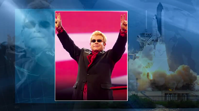 Atlantis – STS135 – Wake-up call on day 6. Rocket Man, sung by Elton John, who briefly addressed the congratulating them for the 3 decades of success. NASA-TV 2011.