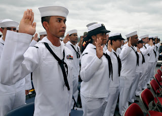 On May 20, 2011, USCIS Seoul Field Office Director Kenneth Sherman presided during a naturalization ceremony on the USS Essex at the Sasebo Naval Base in Japan for 46 sailors, Marines and military family members. (U.S. Navy photo)