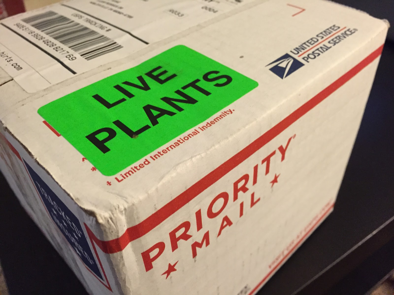 live plants sticker on package