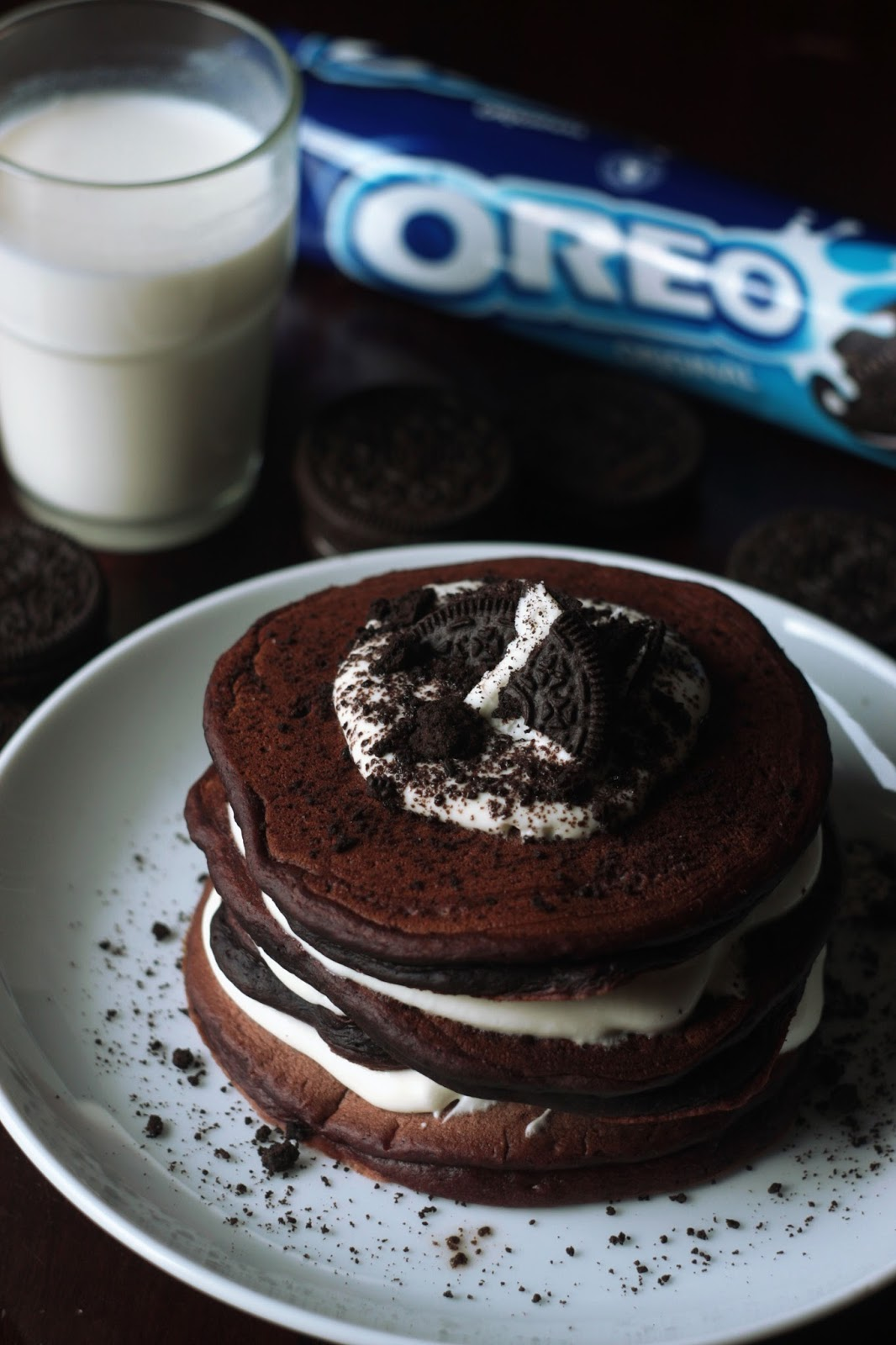 A Yummy Stack of Chocolate Oreo Pancakes with a Glass of Milk - brought to you by Pancake Stories.