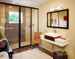 a small modern bathroom design with attractive tiles and a wide window viewing the outside