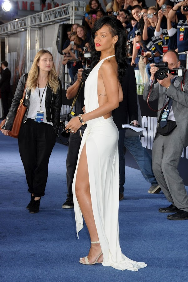 Rihanna poses for photographers on the blue carpet at Battleship premiere in Los Angeles