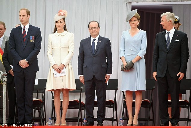 The royal couple, President Hollande and King Philippe and Queen Matilde observe a minute's silence