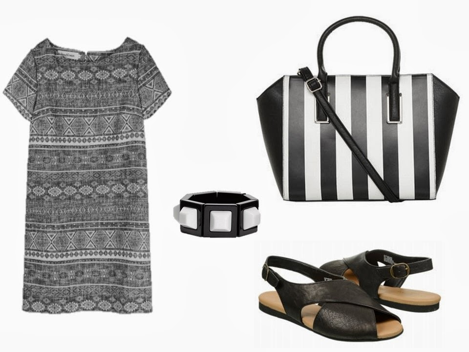 a black and white dress worn with sandals and black and white accessories