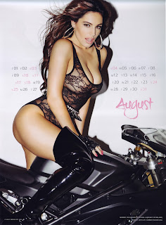 Kelly Brook wearing a see through body suit and sitting on a motorcycle