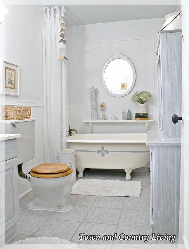 My claw foot tub gets frenchified town country living for Country living bathroom designs