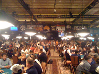 Players taking the first hands of the 2012 WSOP Main Event