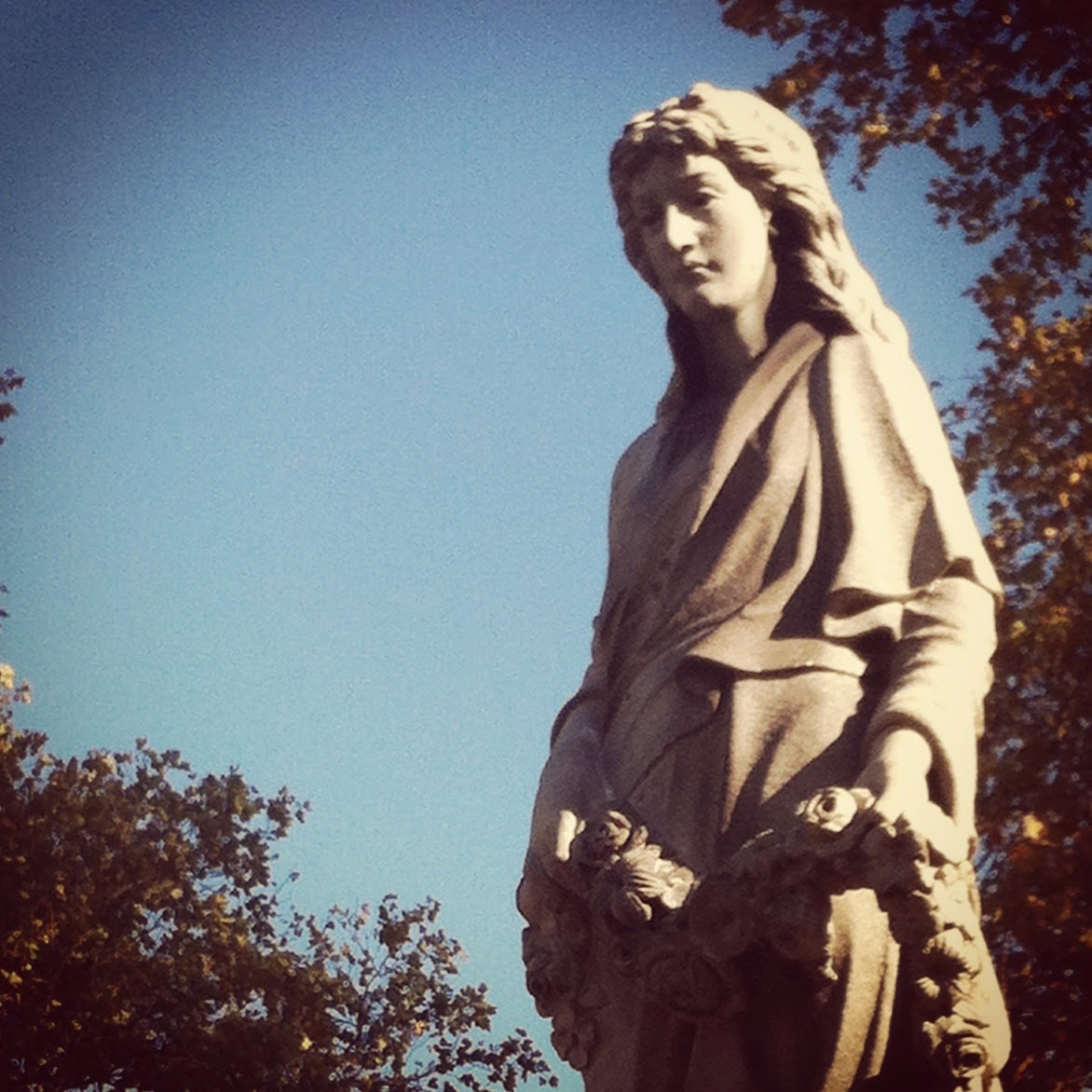 Sculpture of a woman holding a wreath, Green-Wood Cemetery, New York