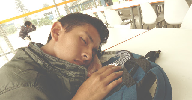Teen boy sleeping during lunch
