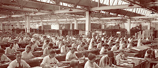 old image of a large industrial era business with hundreds of desks