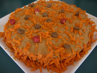 Picture of Rudy's birthday cake - iced with peanut butter & decorated with shredded carrots & kibble